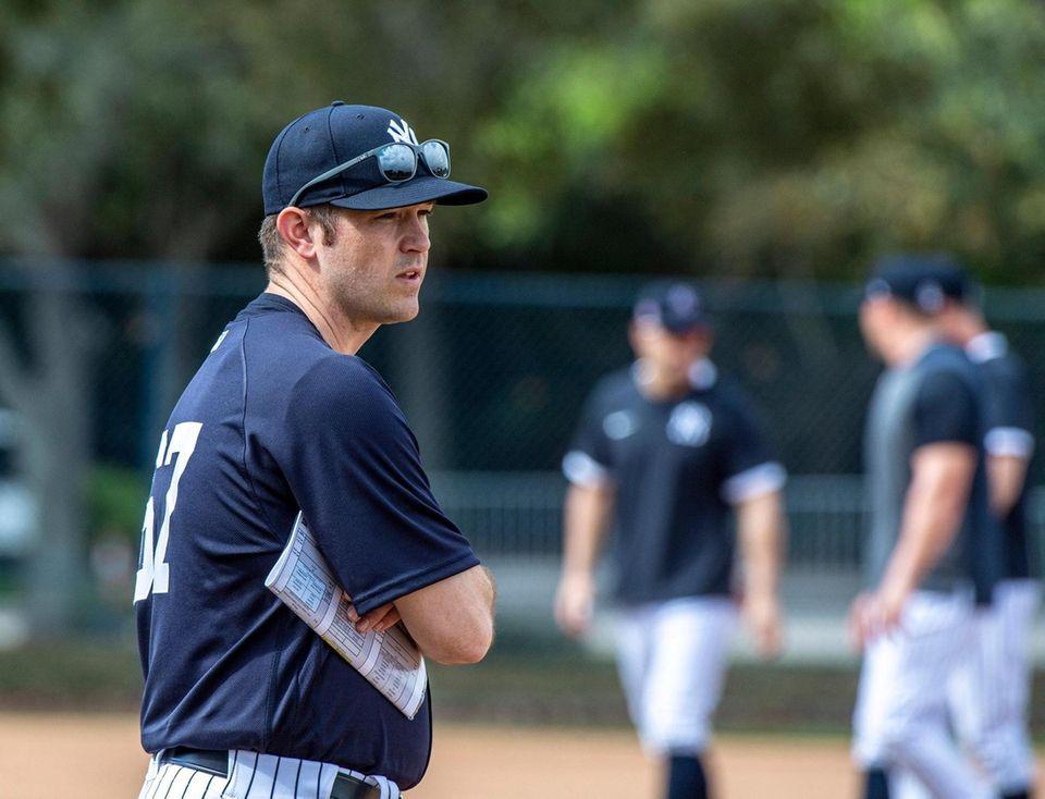 New York Yankees' pitching coach Matt Blake observing