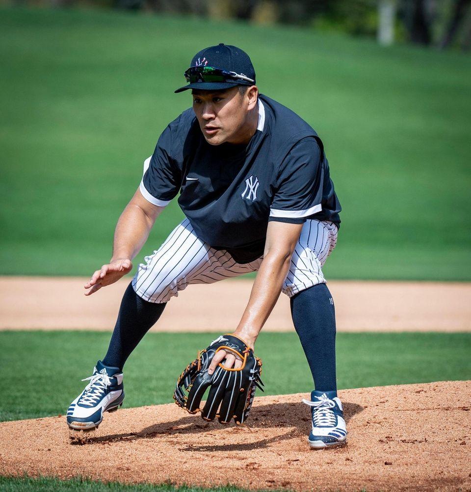 New York Yankees' Masahiro Tanakla fielding balls during