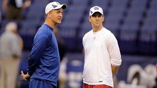 Peyton Manning, left, and his brother Eli Manning