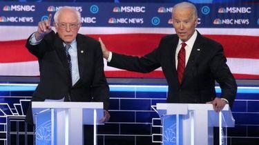 Democratic presidential candidate Sen. Bernie Sanders (I-VT) (L)