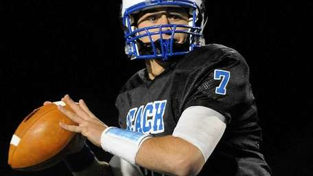 Long Beach High School quarterback Adam Salvadori throws
