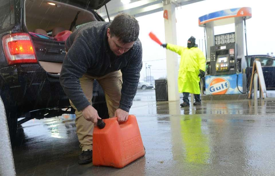 Jim Myer, of Ronkonkoma, fills gas cans at