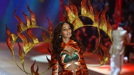 Puerto Rican fashion model Joan Smalls wears fashions