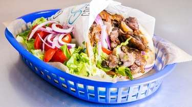 Pork Gyro Pita with lettuce, tomato and onion