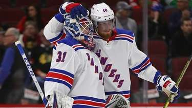 Igor Shesterkin of the Rangers is congratulated by