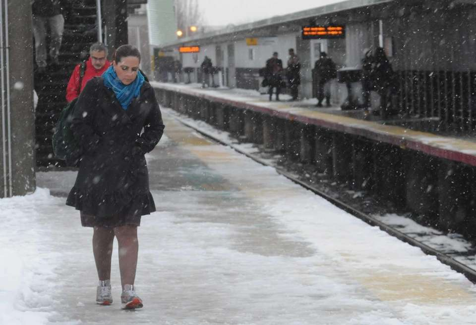 LIRR commuters wait for a train at Ronkonkoma