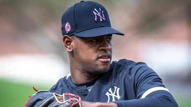 Yankees' pitcher Luis Severino warming up his arm