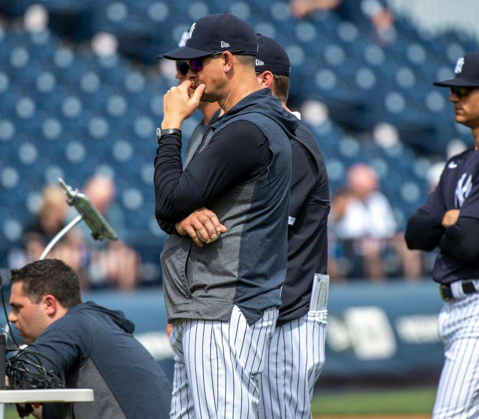 New York Yankees' manager Aaron Boon watching pitcher