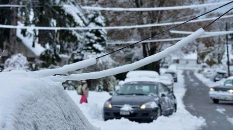 Downed lines on Crosby Avenue in Albertson from