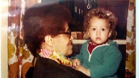 Winifred C. Deare holds her grandson, Zebulon Vance