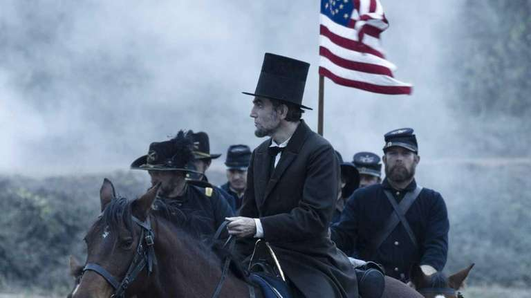 President Abraham Lincoln (Daniel Day-Lewis) looks across a