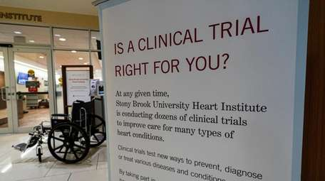 A sign promotes participation in clinical trials at