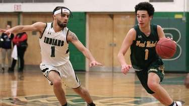 Ward Melville guard Giancarlo Serratore moves into the