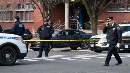 Crime scene tape is strung across the perimeter