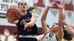 Katie McMahon of South Side, left, makes an