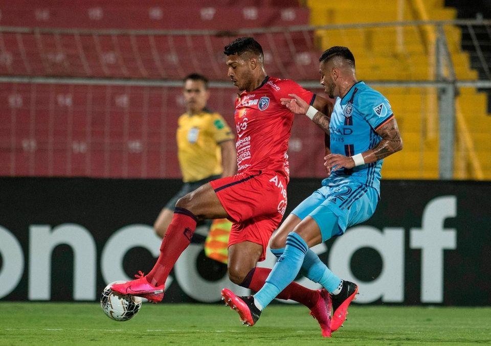 San Carlos player Jorman Aguilar (L) vies for
