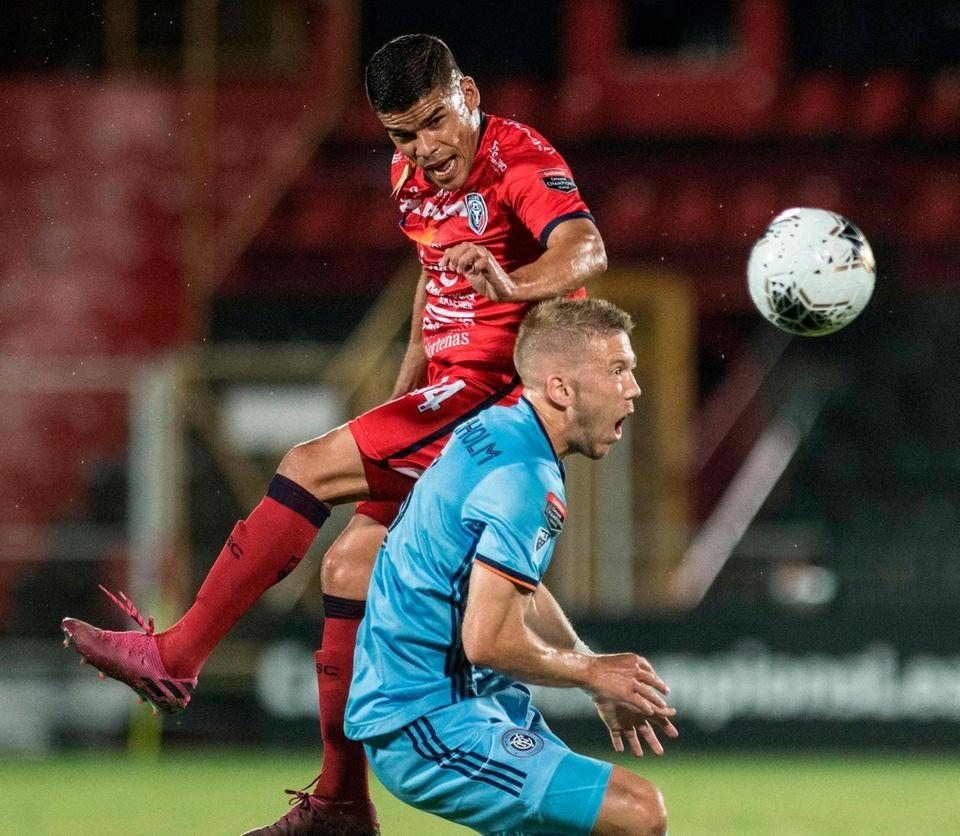 San Carlos player Jose Sanchez (L) vies for