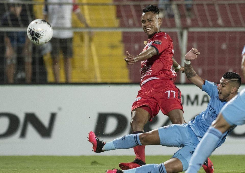 San Carlos player Julio Cruz (L) vies for
