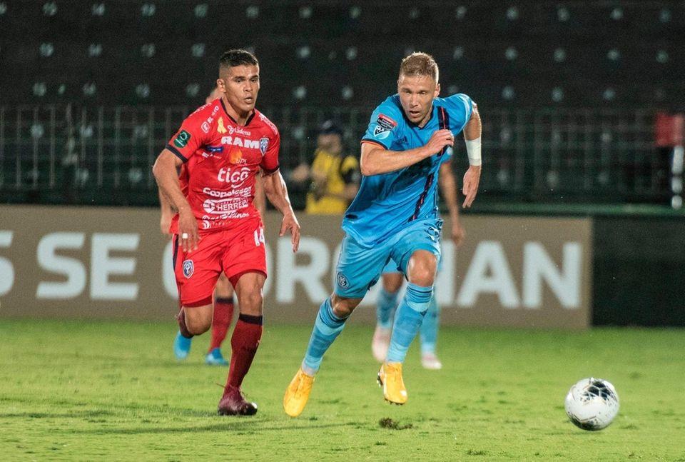 San Carlos player Marcos Mena (L) vies for