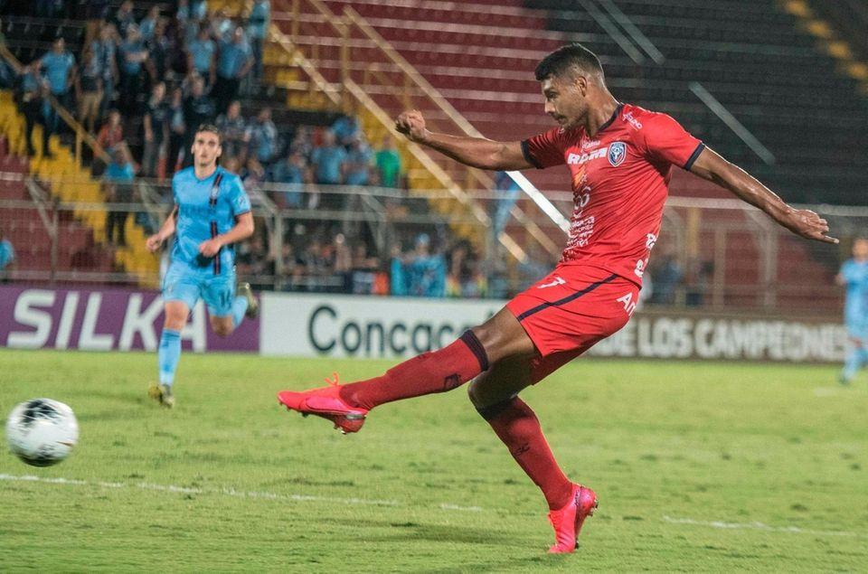 San Carlos player Jorman Aguilar scores against New