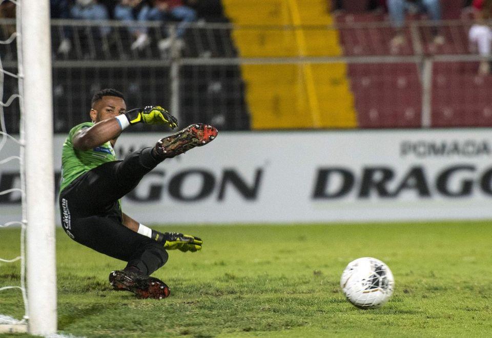 San Carlos goalkeeper Patrick Pembertom watches a goal