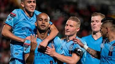 New York City FC's Heber celebrates with teammates