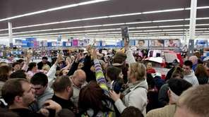 Shoppers vie for copies of video games at