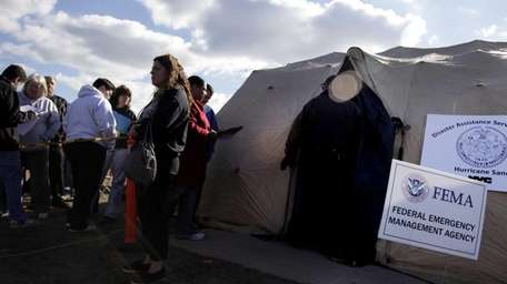 People effected by Superstorm Sandy wait in line