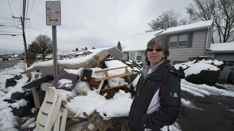 Oceanside resident Debbie Gustus stands by her garbage