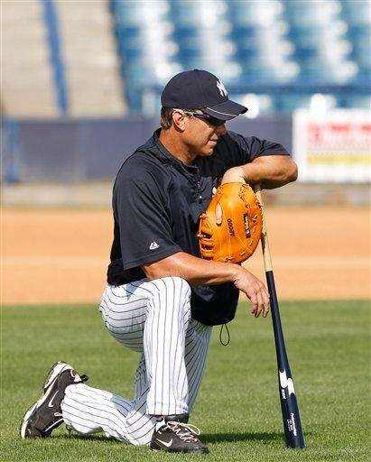 Tino Martinez leans on his bat during a