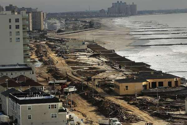 Mounds of debris line the Rockaway's iconic boardwalk