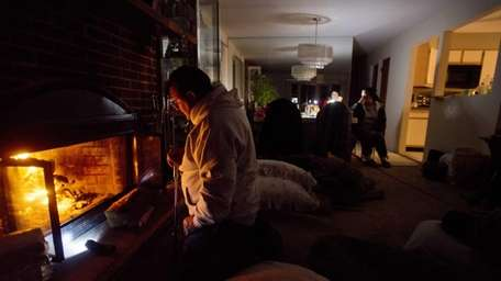 Michael LaRocca stokes the fire at his mother