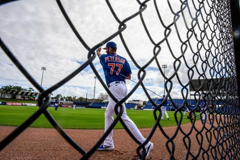 New York Mets pitcher David Peterson doing resistance