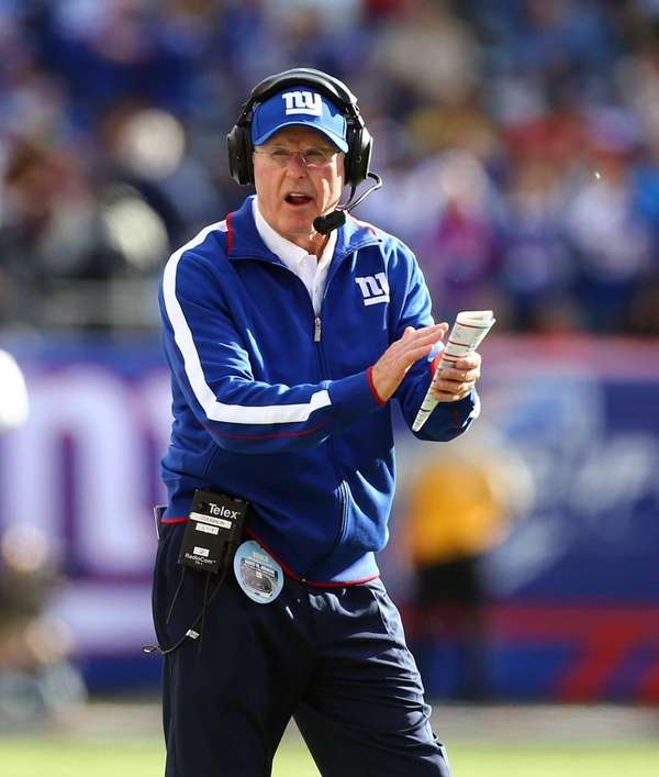 Tom Coughlin celebrates a touchdown during a game
