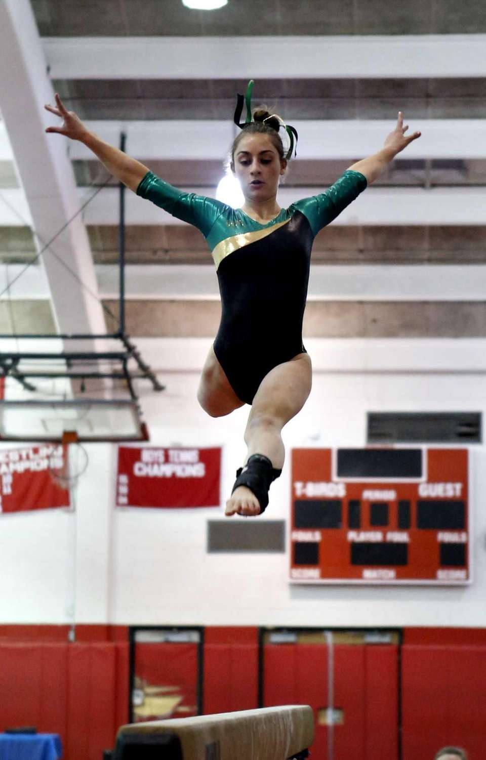 Ward Melville's Alison Larocca leaps on the beam