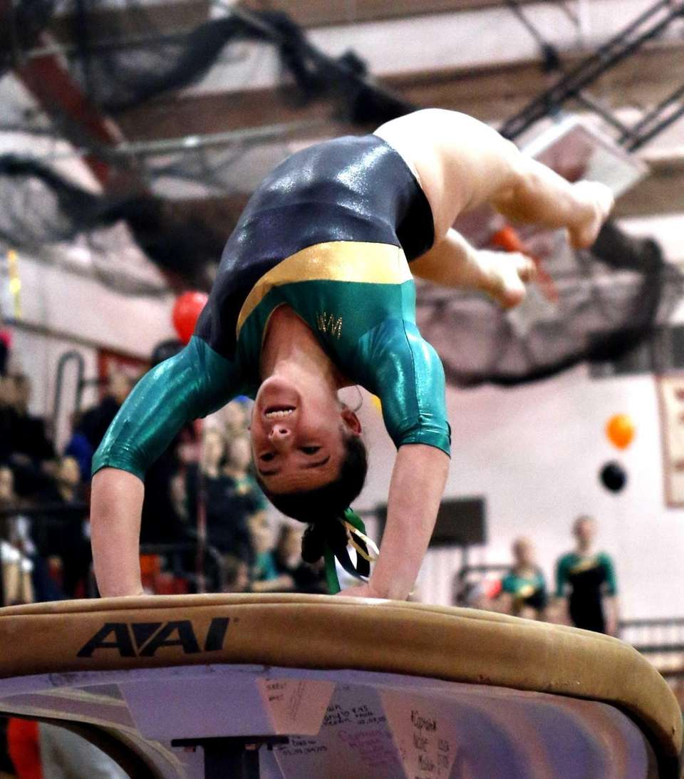 Ward Melville's Cydney Crasa works the vault during