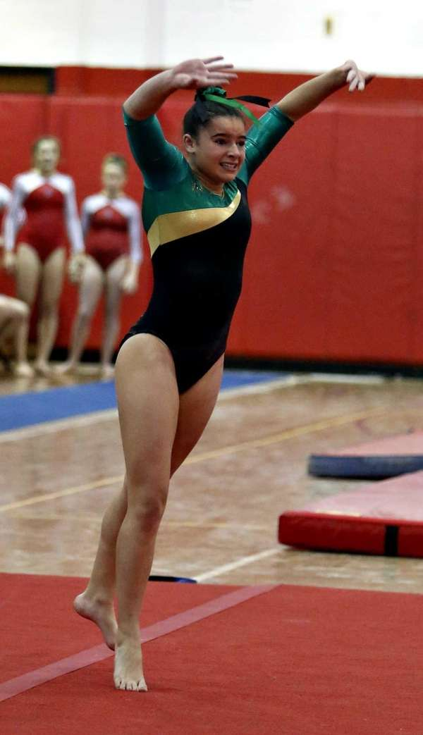 Ward Melville's Cydney Crasa performs the floor exercise