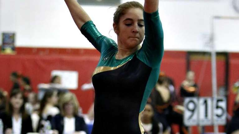 Ward Melville's Kristen Cannon leaps during the floor