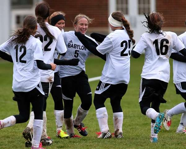 Babylon's Shelby Fredericks is congratulated by her teammates