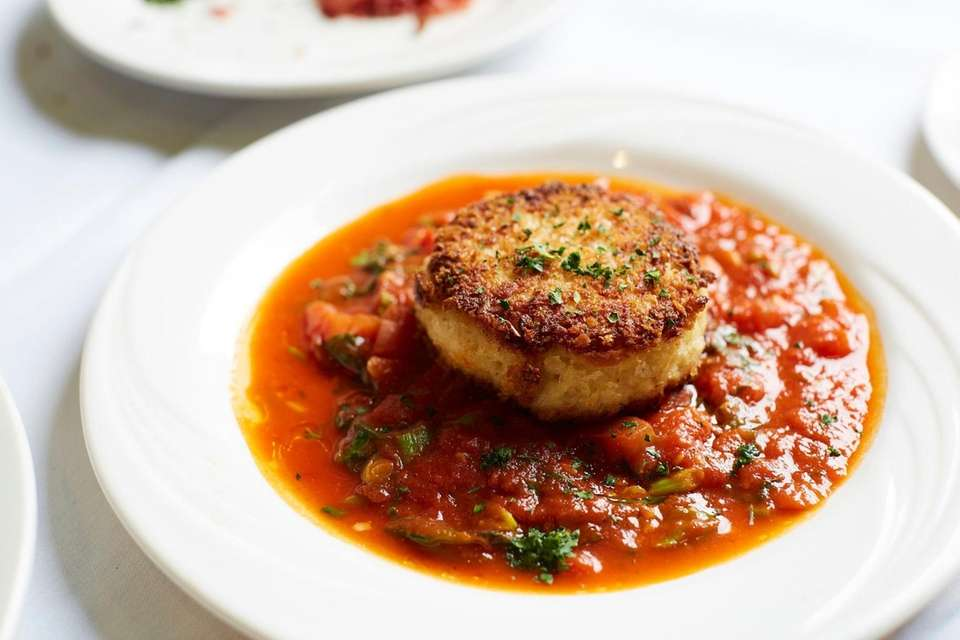 Crabcakes are fried 'til copper, tightly packed with