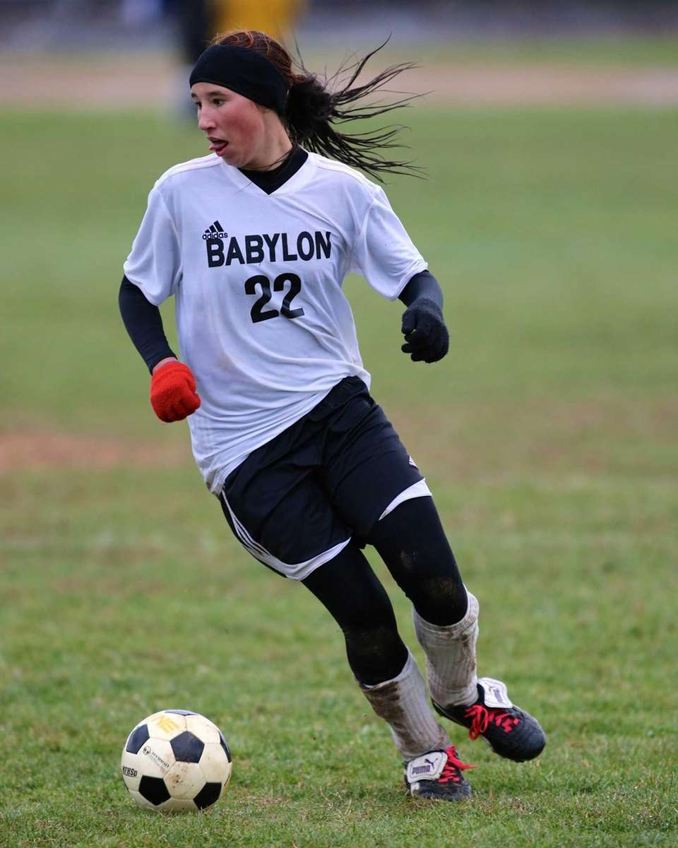 Babylon's Shannon Hartigan dribbles down the field against