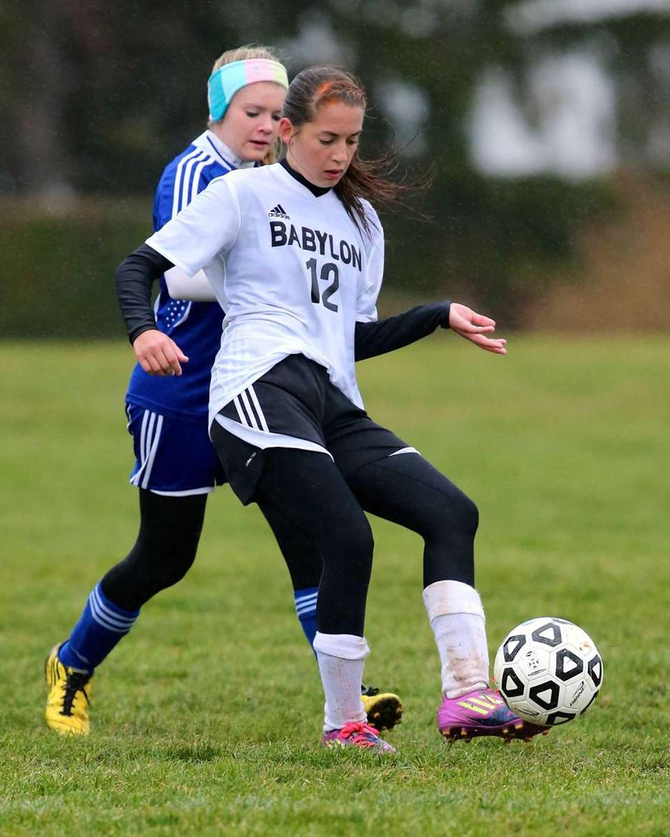 Babylon's Shayne Antolini fights for possession against Mattituck