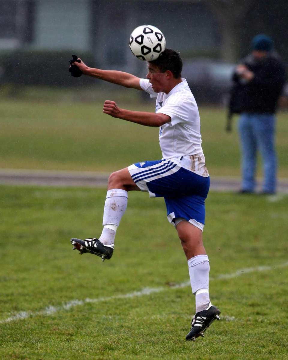 Mattituck's James Hayes heads the ball against Southampton