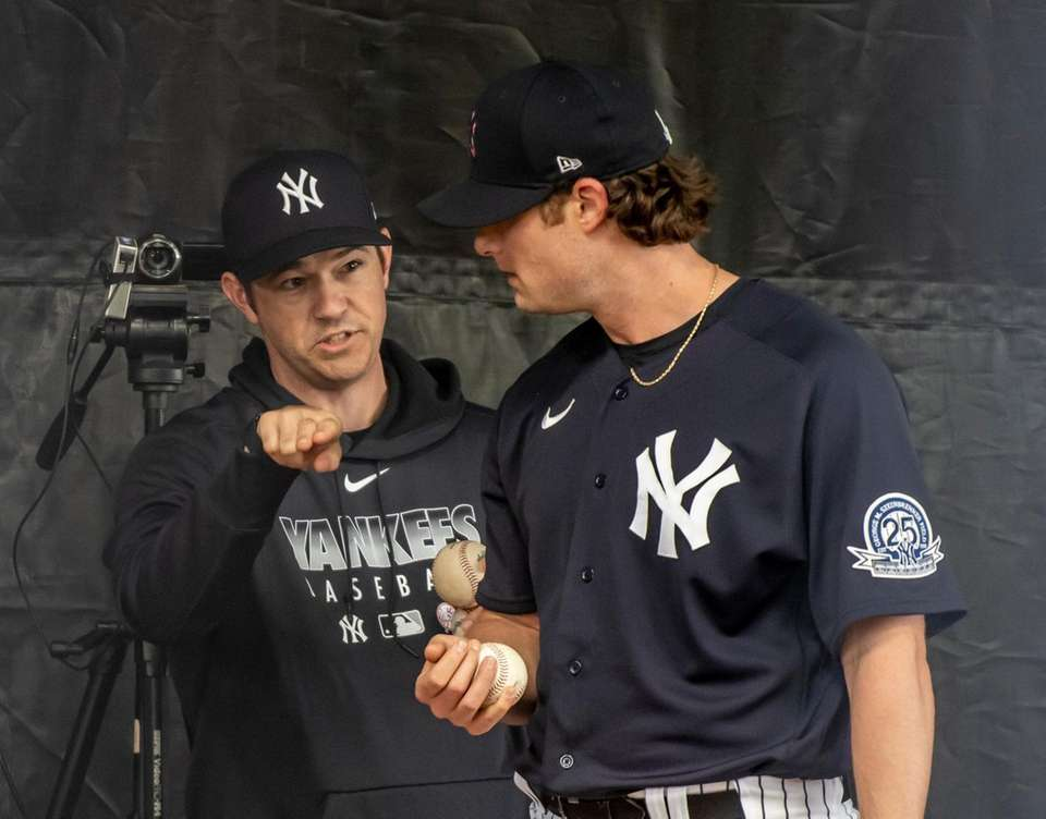 New York Yankees' pitcher Gerrit Cole and pitching