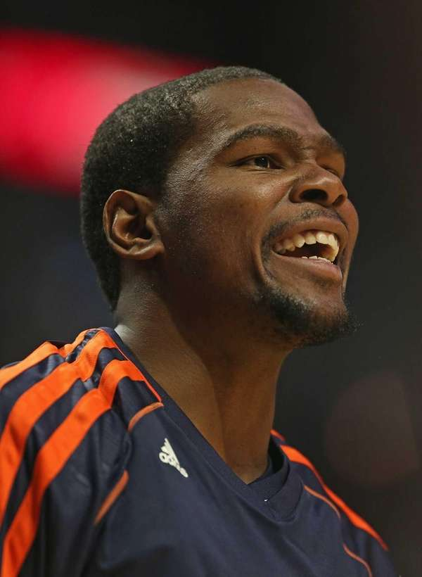 Kevin Durant yells encouragement from the bench during