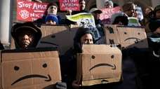 Protesters rally against Amazon's plan for second headquarters