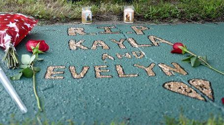 Street memorial honoring Kayla Cuevas, Nisa Mickens and