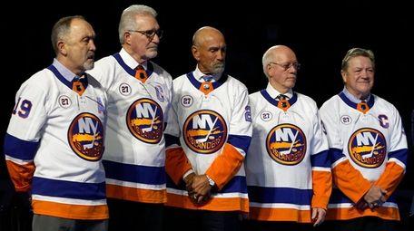 Former New York Islanders, from left, Bryan Trottier,