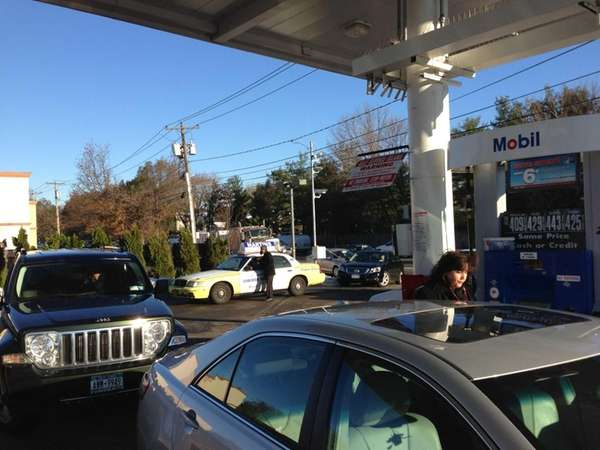 Motorists line up for gas on the first