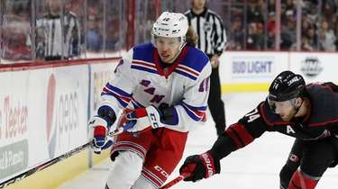 Rangers left wing Artemi Panarin controls the puck